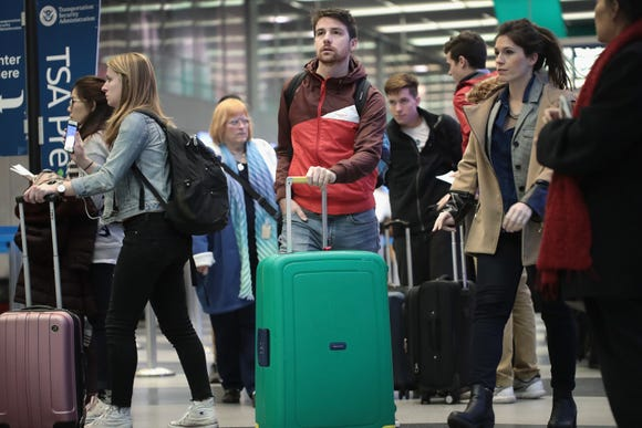 Passengers arrive for their flights at Chicago O'Hare International Airport on Nov. 23, 2016.