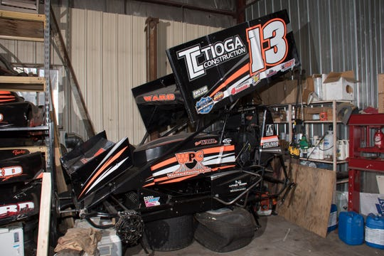 The race car driven by Kevin Ward Jr. on the night he was struck and killed in 2014 sits in his father's garage.