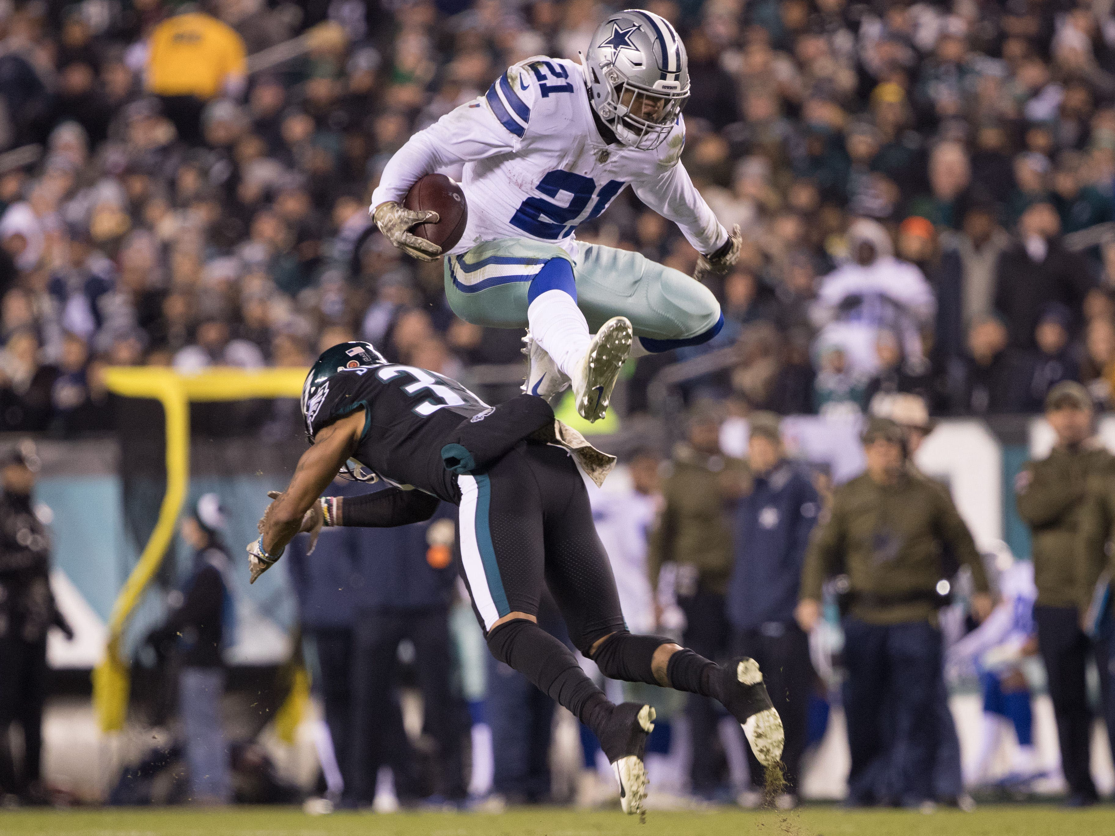 Week 10: Dallas Cowboys running back Ezekiel Elliott leaps over the tackle attempt of Philadelphia Eagles defensive back Tre Sullivan during the second quarter at Lincoln Financial Field. The Cowboys won the game, 27-20.