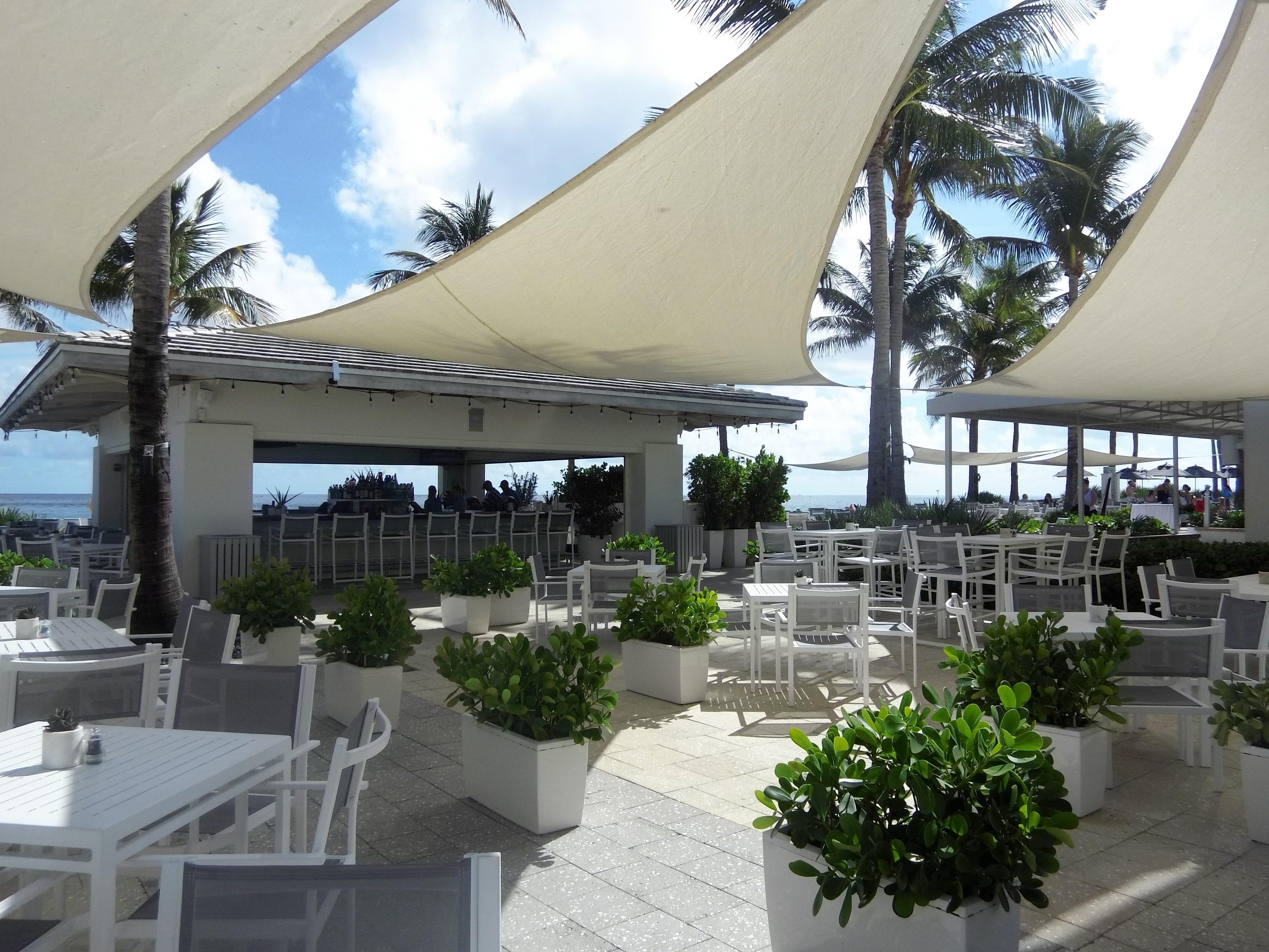 Outdoor seating at Beaches Restaurant and Bar at Boca Beach Club.