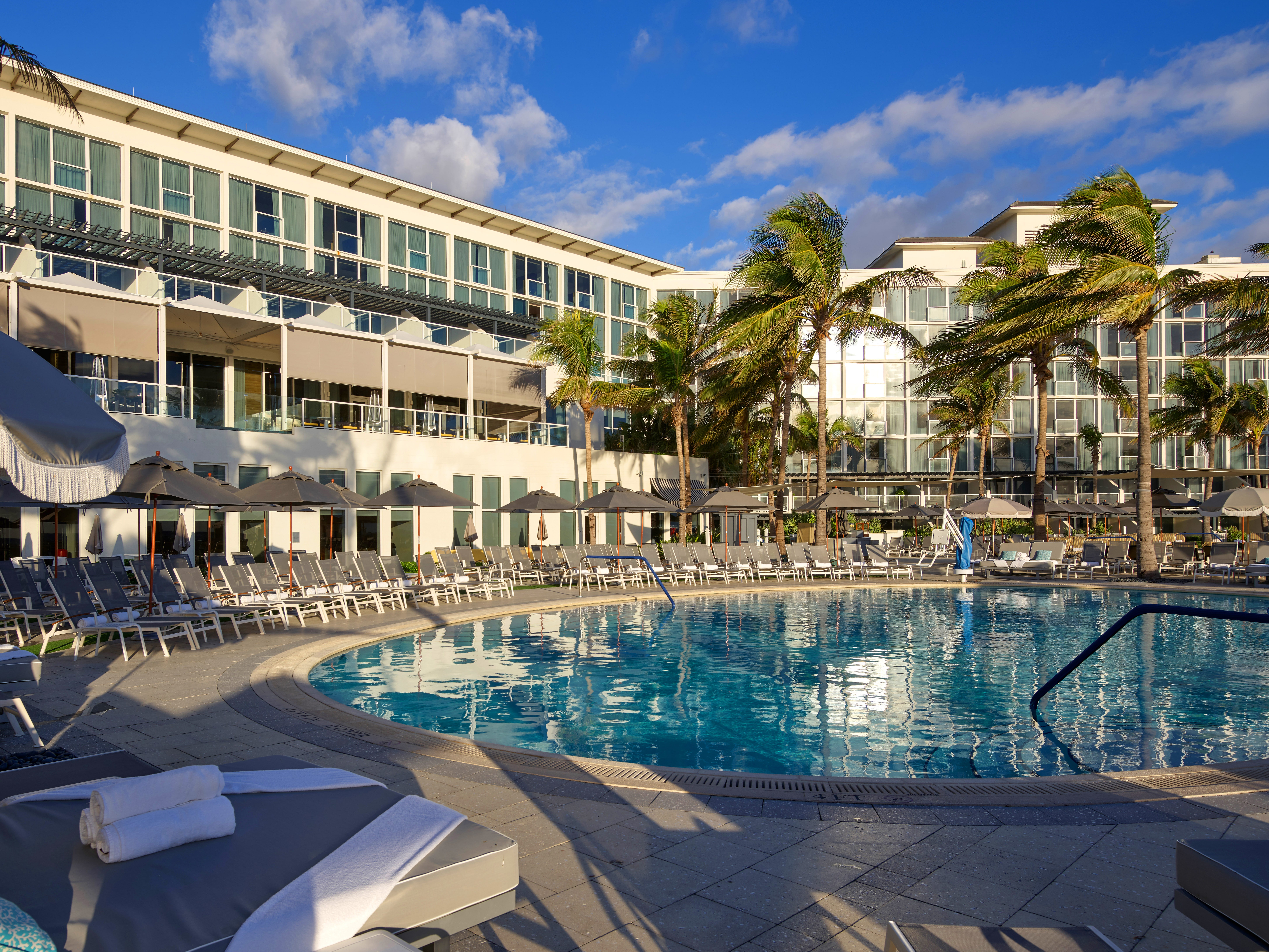 Guest rooms at Boca Beach Club overlook one of the pools as well as the Atlantic Ocean.