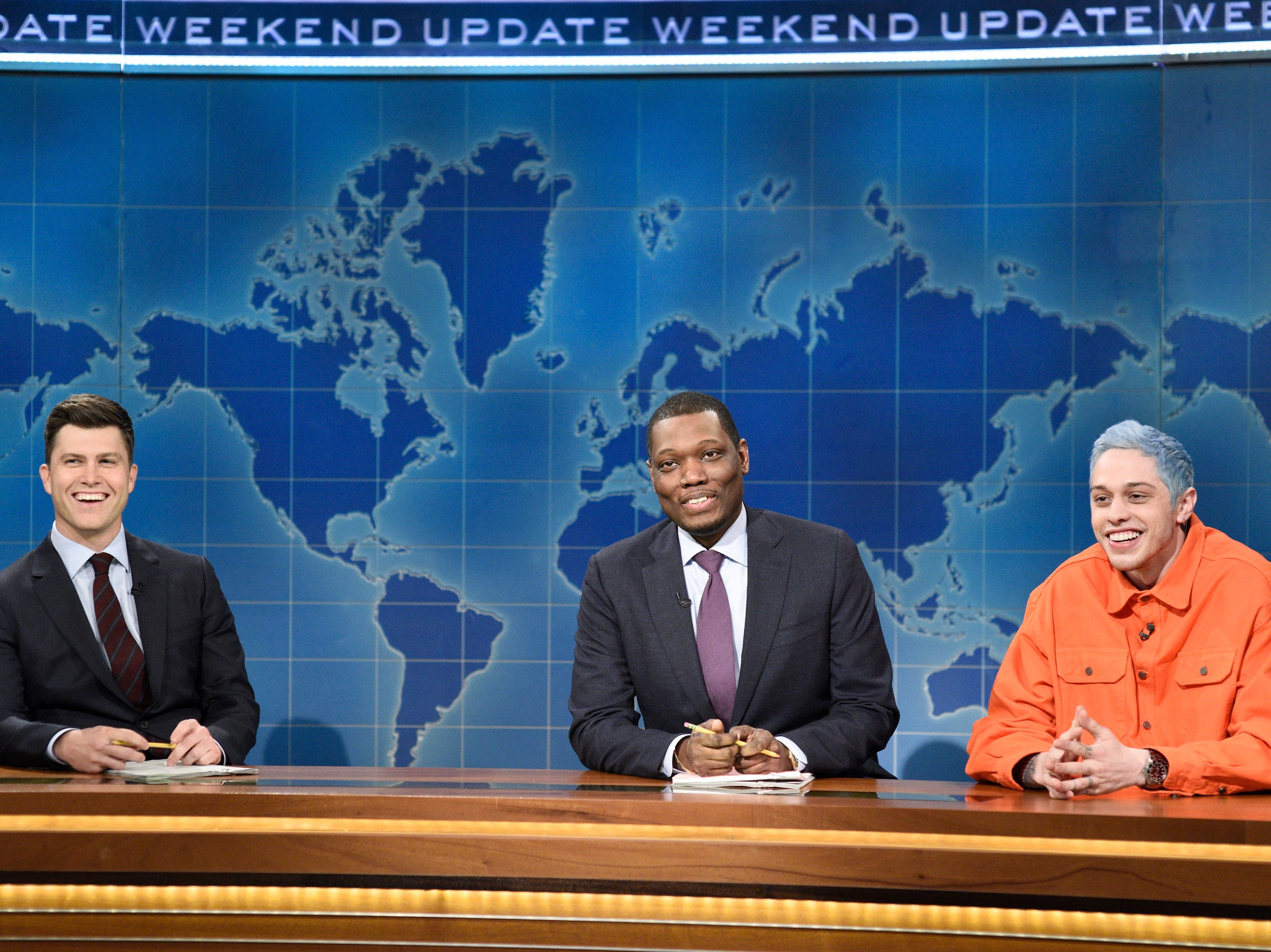 "SATURDAY NIGHT LIVE -- ""Jonah Hill"" Episode 1750 -- Pictured: (l-r) Colin Jost and Michael Che with Pete Davidson during ""Weekend Update"" in Studio 8H on Saturday, November 3, 2018 -- (Photo by: Will Heath/NBC)"