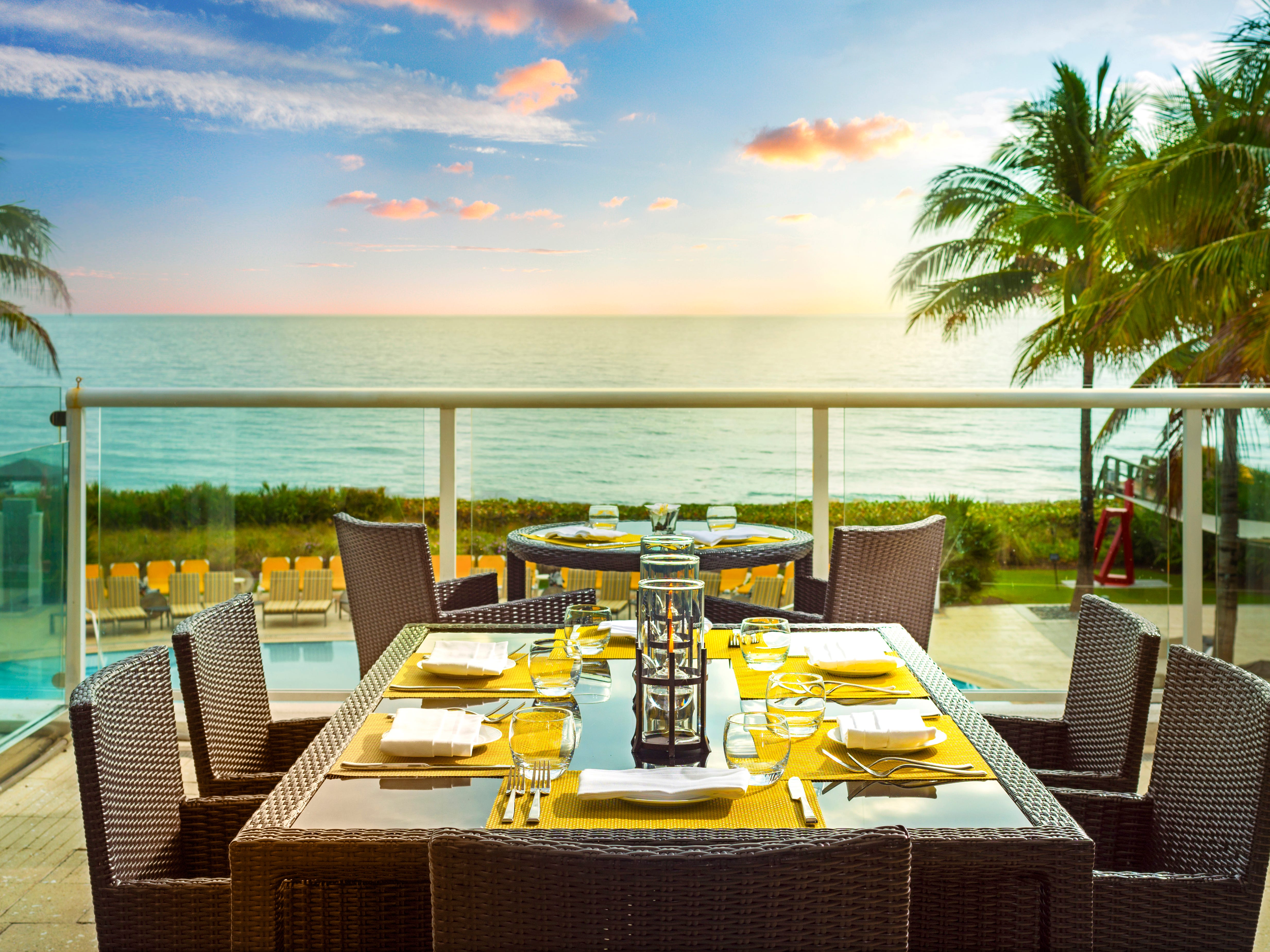 Outdoor dining at SeaGrille at Boca Beach Club.