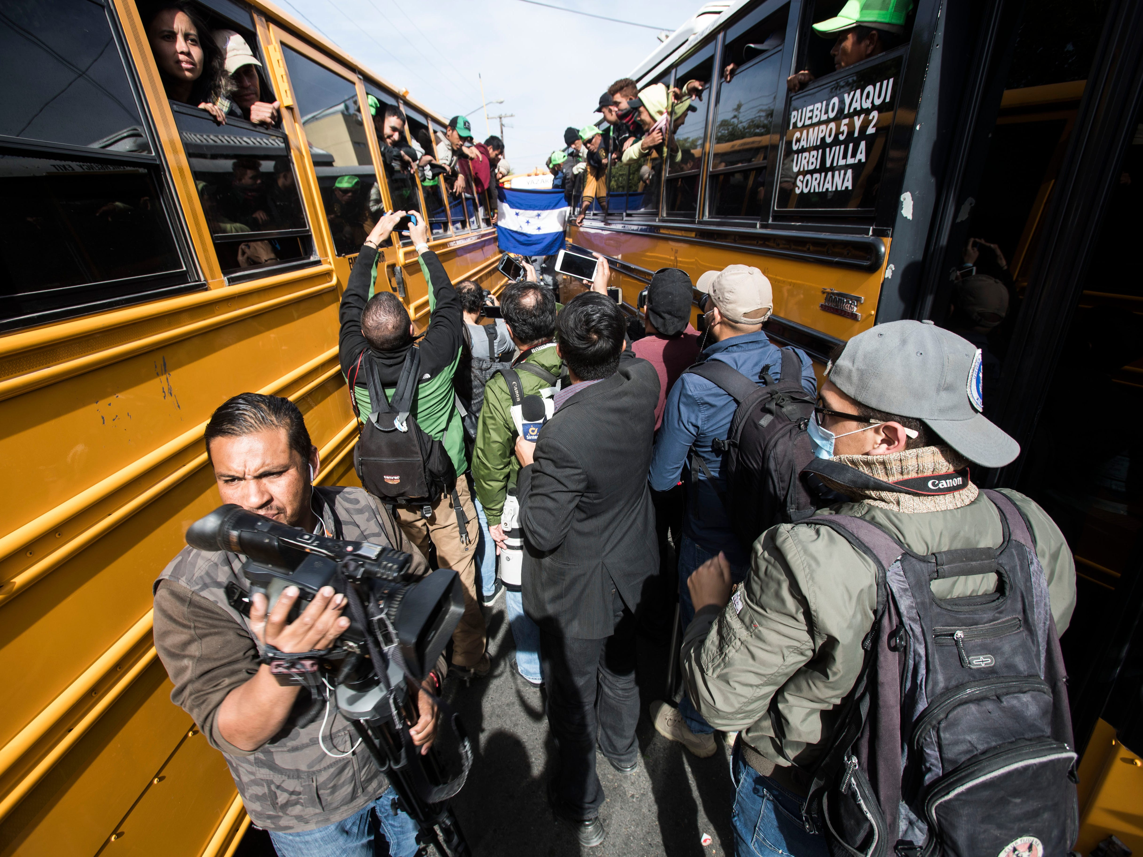Mexican media swarm members of the fist wave of the migrant caravan as they arrive in Tijuana, Mexico on Nov. 13, 2018.