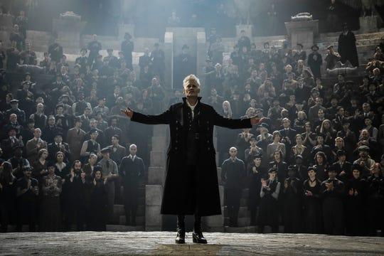 Dark wizard Gellert Grendelwald (Johnny Depp) gathers followers for his sinister ideology.