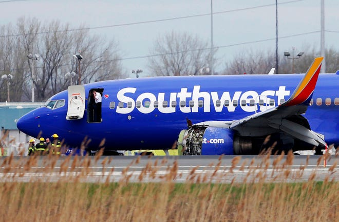 This file photo from April 17, 2018, shows a Southwest Airlines plane on the runway at the Philadelphia International Airport after it made an emergency landing there.