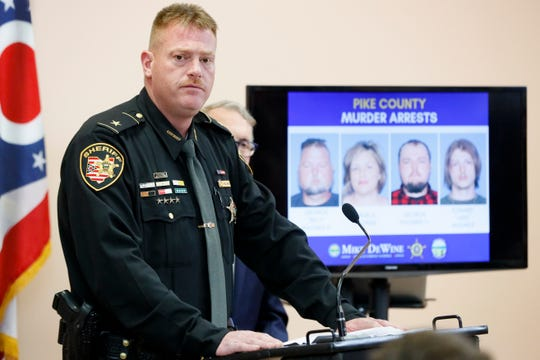 Pike County Sheriff Charles Reader discusses developments on Tuesday into the slayings of eight members of one family in rural Ohio two years ago.