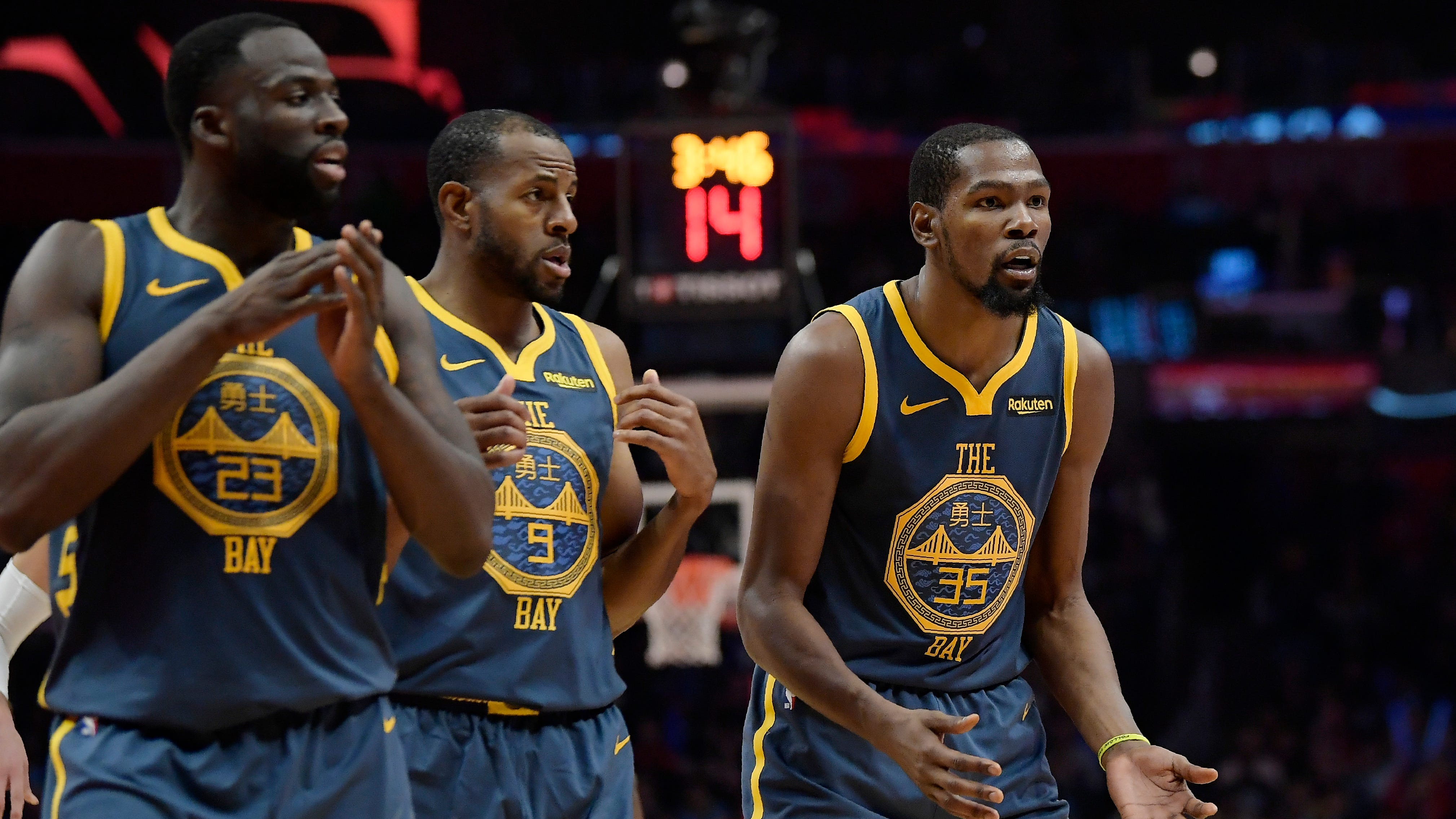 Golden State Warriors forwards Kevin Durant, Andre Iguodala and Draymond Green.