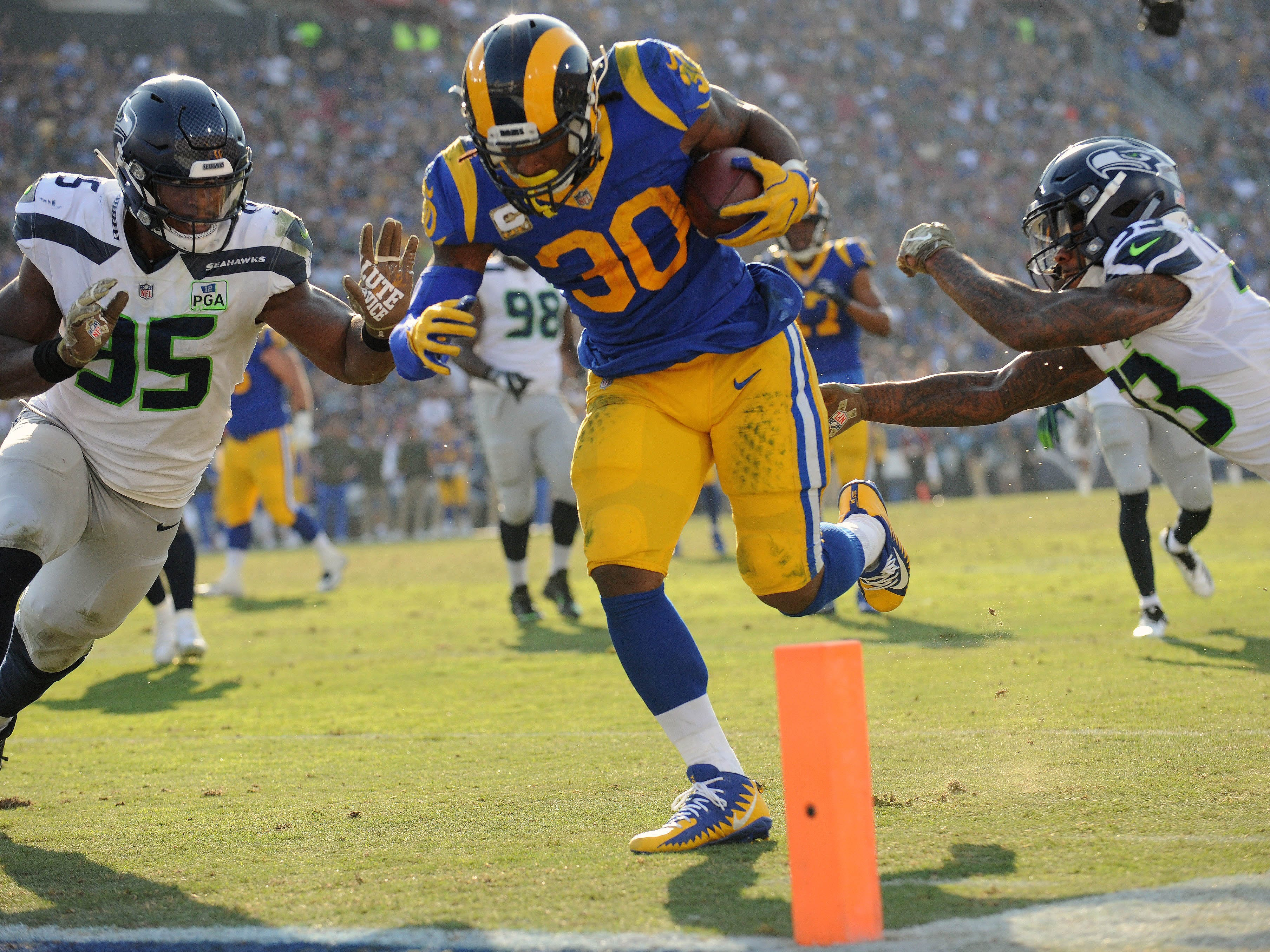 Week 10: Los Angeles Rams running back Todd Gurley runs for a touchdown against the Seattle Seahawks during the first half at the Los Angeles Memorial Coliseum. The Rams won the game, 36-31.