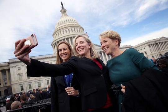 Newly elected Democratic members of the House of Representatives Abigail Spanberger of Virginia, center, Mikie Sherrill, left, of New Jersey and Chrissy Houlahan of Pennsylvania take a selfie in front of the U.S. Capitol following an official class picture of new representatives on Nov. 14, 2018, in Washington, D.C.