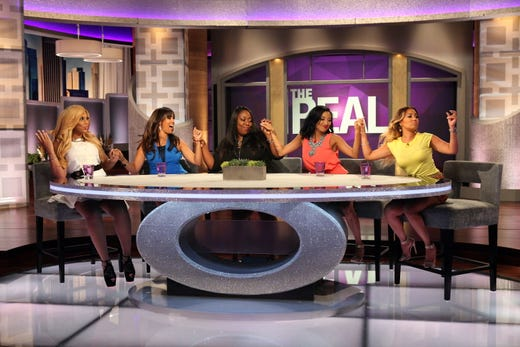 """Bailon, right, now co-hosts """"The Real,"""" previously with fellow Disney Channel alum Tamera Mowry-Housley."""