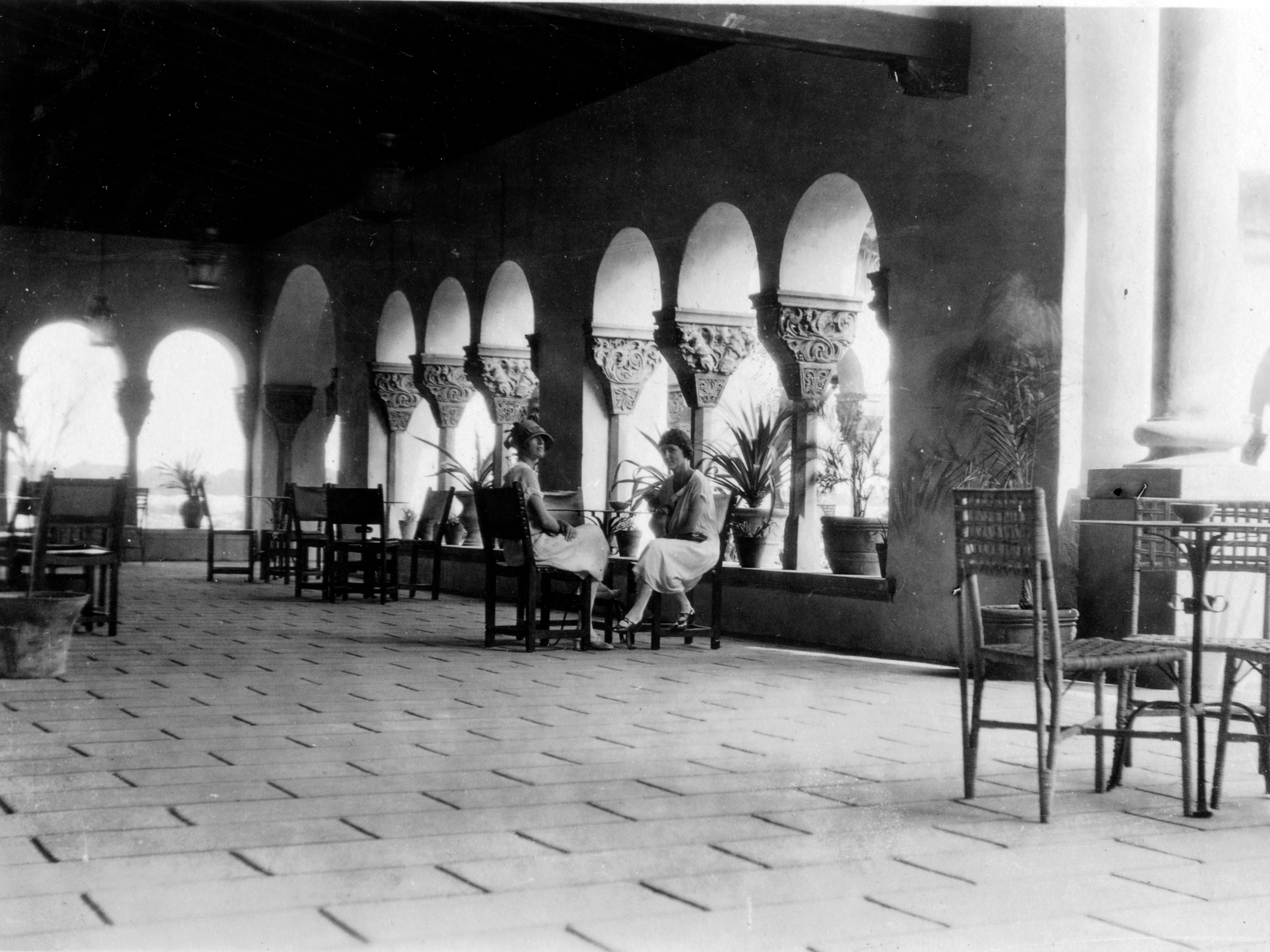 An historic photo of guests in the loggia.