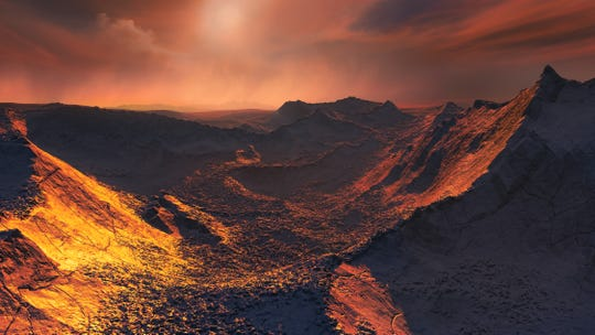 An artist's impression of the surface of the planet that's orbiting Barnard's Star, the nearest single star to the sun. Data from a worldwide array of telescopes have revealed this frozen, dimly lit world.