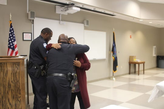 Lamona Wallace hugs Deputy Chief Cedric Green after receiving her graduation certificate from the Alexandria Police Department's Citizens Academy.