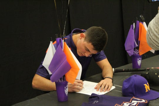 """Leesville senior baseball player Johnathan Harmon signs his NLI to Northwestern State on Wednesday. Leesville's softball team also had two signees as Keyana """"KeKe"""" Poteat signed with LSU of Eunice and Ryleigh Hicks signed with Louisiana College."""