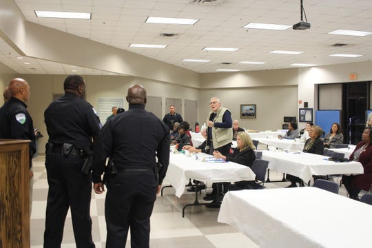 Arthur Hammond (right) compliments the Alexandria Police Department on the last night of its citizens academy.