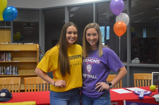 Pineville seniors Adelle Chapman (left) and Kacee Mertens pose after signing to colleges Wednesday. Chapman signed a non-binding waiver to Mississippi College and Mertens signed her NLI to Northwestern State.