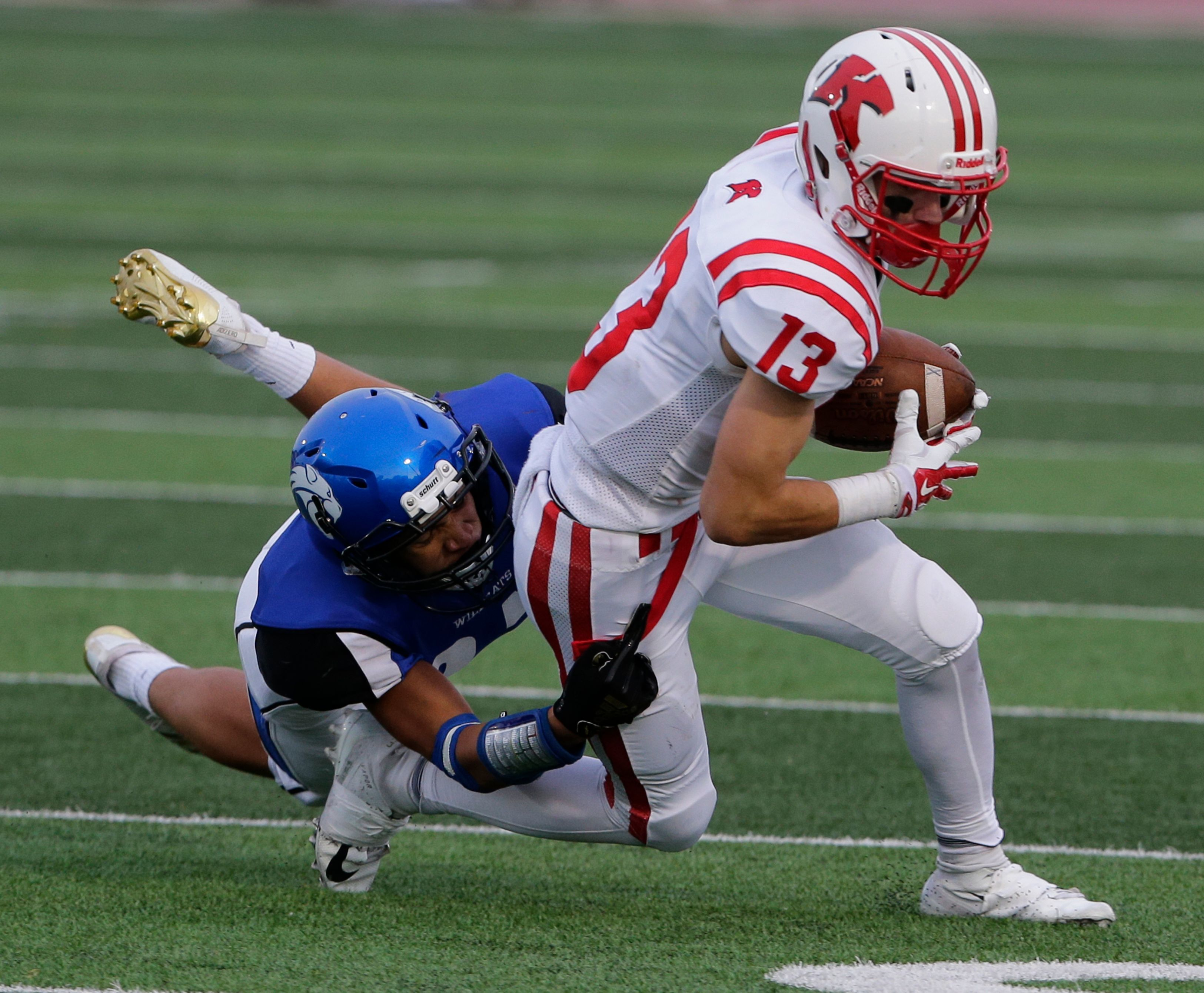 Kimberly's Zach Lechnir makes a catch against Oshkosh West during a Valley Football Association game on Sept. 7 at Titan Stadium in Oshkosh.