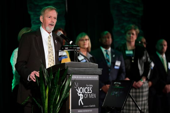 Tom Berkedal, president of Fox Valley Voices of Men leadership team, talks about the resignation of the group's former community engagement leader, Shannon Kenevan, during the 2018 Voices of Men Call to Action event Thursday at the Red Lion Hotel Paper Valley in downtown Appleton.