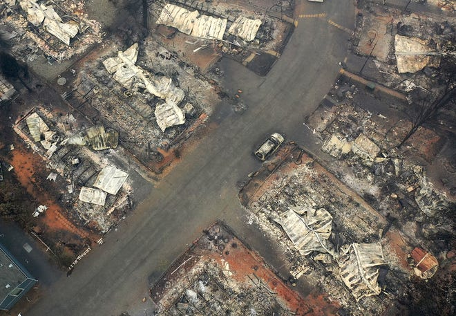 PARADISE, CA - NOVEMBER 15:  An aerial view of a neighborhood destroyed by the Camp Fire on November 15, 2018 in Paradise, California. Fueled by high winds and low humidity the Camp Fire ripped through the town of Paradise charring over 140,000 acres, killing at least 56 people and destroying over 8,500 homes and businesses. The fire is currently at 40 percent containment.  (Photo by Justin Sullivan/Getty Images)