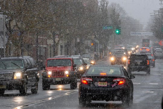 Taffic winds its way down Broad Street in Red Bank as the Noreaster moves in.