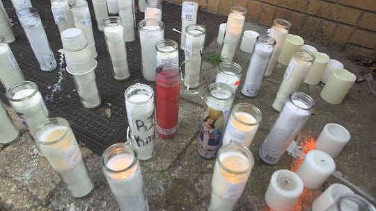 Candles left in memorial to Randolf Goodman, who was murdered outside his home in Neptune Township