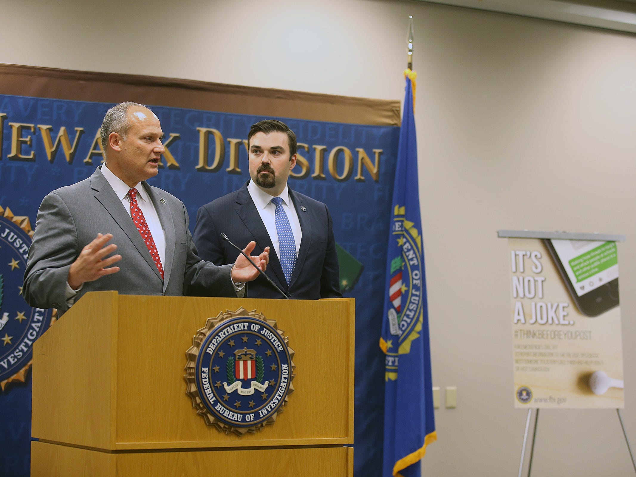 Christopher K. Stangl, assistant special agent in charge for FBI, and Jared Maples, director of Homeland Security and Preparedness, launch their #thinkbeforeyoupost campaign and discuss the topic of hoax threats during a press conference at the Federal Bureau of Investigation headquarters in Newark, NJ Thursday, November 15, 2018.