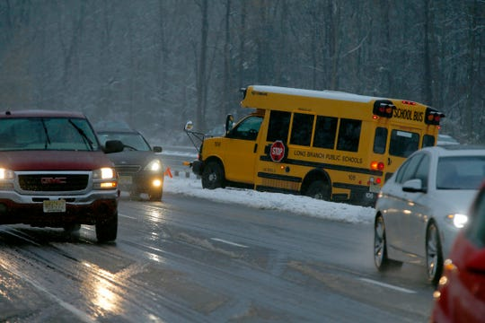 A Long Branch school bus sits in the median of Route 18 Northbound in Colts Neck Thursday afternoon, November 15, 2018, after it apparently spun out on the slick roadway.