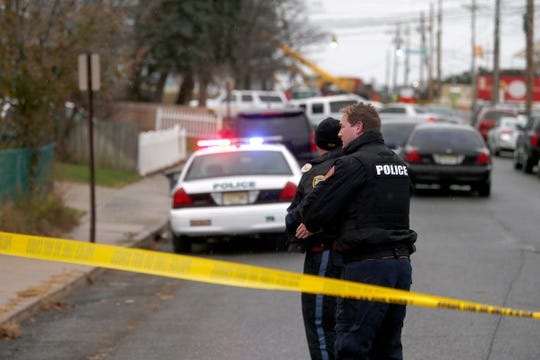 Long Branch police officers are shown at the scene of a reported shooting on Morris Avenue Thursday afternoon, November 15, 2018.