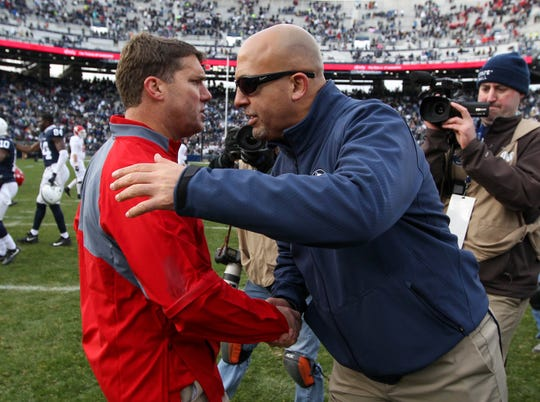 Nov 11, 2017; University Park, PA, USA; Penn State Nittany Lions head coach James Franklin (right) shakes hands with Rutgers Scarlet Knights head coach Chris Ash (left) following the competition of the game at Beaver Stadium. Penn State defeated Rutgers 35-6. Mandatory Credit: Matthew O'Haren-USA TODAY Sports