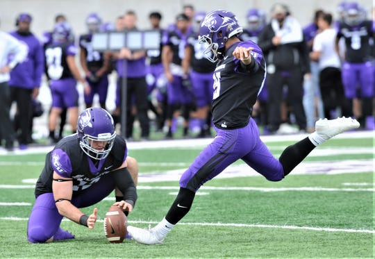 ACU's Oscar Hernandez, right, kicks a PAT during the Wildcats' game against Northwestern State. Hernandez kicked five PATs and a pair of 23-yard field goals in ACU's 49-47 victory over the Demons on Saturday, Nov. 3, 2018, at Wildcat Stadium.