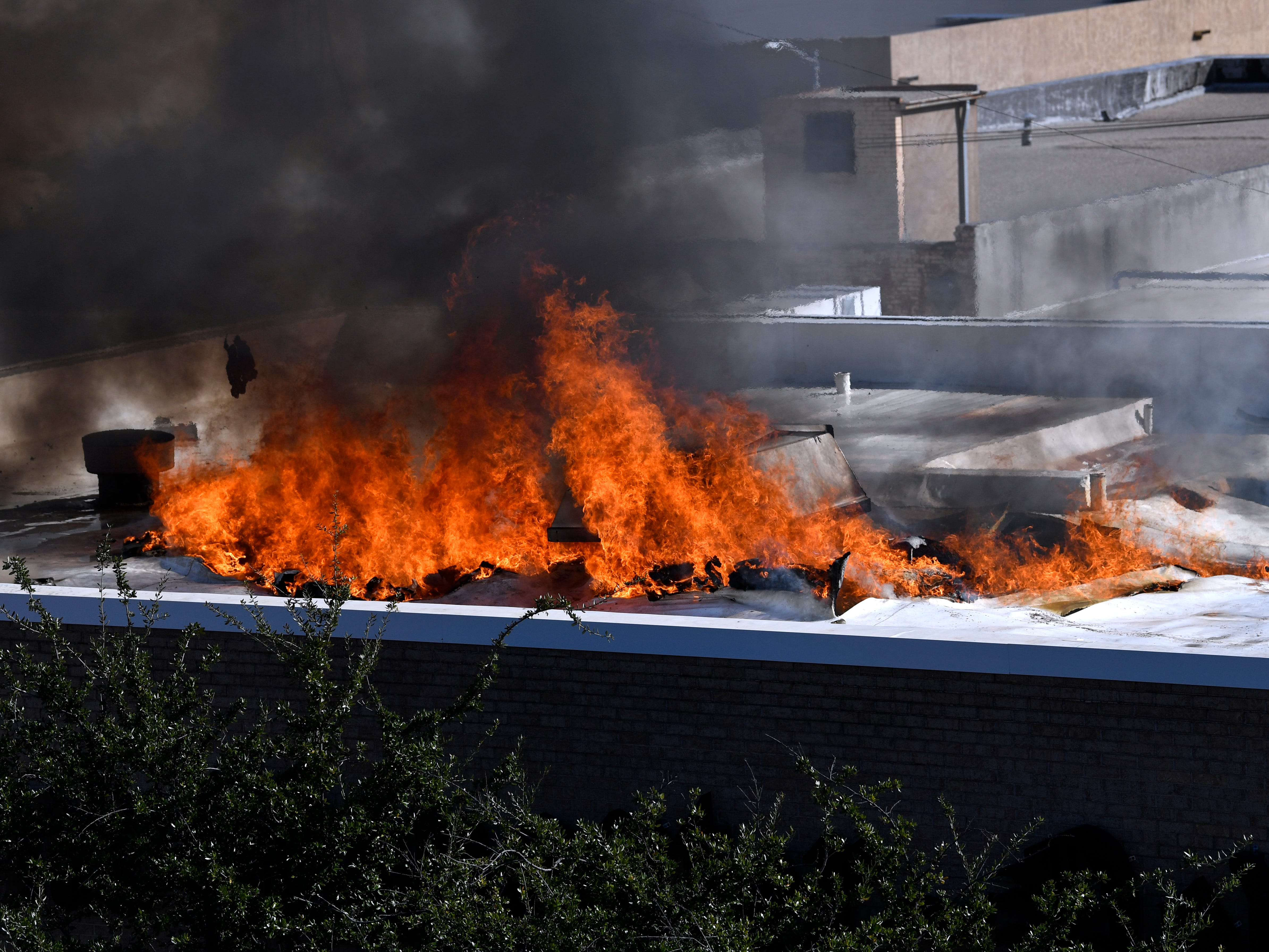 Fire burns on the roof of the Abilene Reporter-News Thursday Nov. 15, 2018. The fire was called in at 9:20 a.m., at one time all three of the city's ladder trucks were employed during the fight.