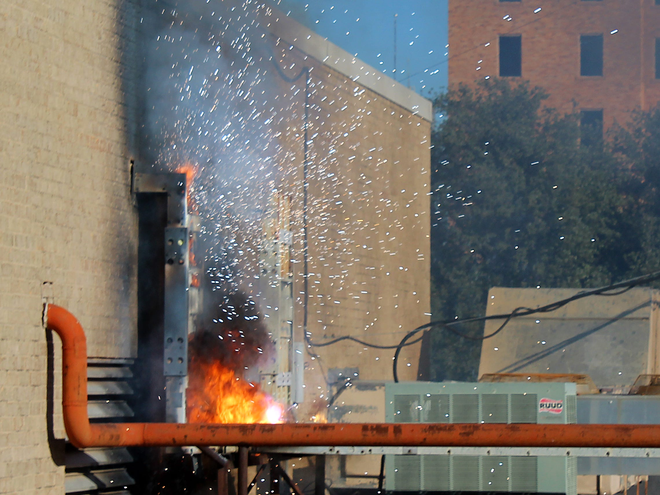 Sparks fly from the east side of the Abilene Reporter-News utility room, located on the roof, Thursday Nov. 15, 2018. The sparks developed into a two-alarm fire, forcing the evacuation of the newspaper.
