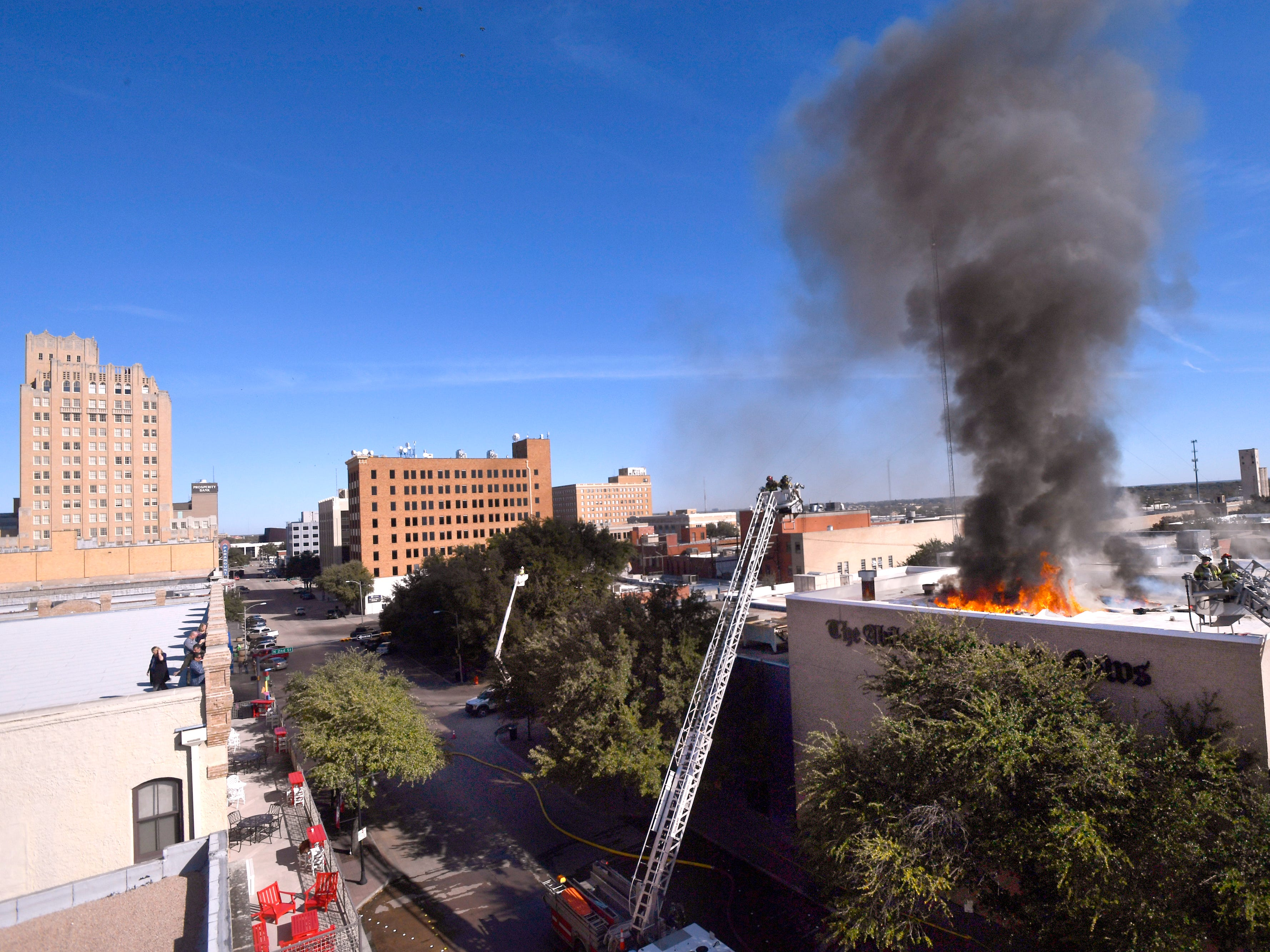 Abilene firefighters respond to a two-alarm blaze at the Abilene Reporter-News Thursday Nov. 15, 2018. The fire was called in at 9:20 a.m., at one time all three of the city's ladder trucks were employed during the fight.,