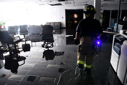 An Abilene firefighter escorts Ron Erdrich through the Abilene Reporter-News to retrieve hard drives and other items from the newsroom. The fire department responded to a two-alarm blaze at the newspaper Thursday Nov. 15, 2018. The fire was called in at 9:20 a.m., at one time all three of the city's ladder trucks were employed during the fight.