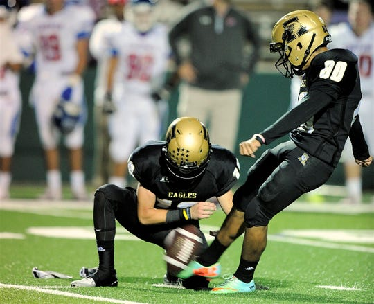 Abilene High kicker Oscar Hernandez (80) attempts a field goal during the fourth quarter of the Eagles' 38-7 win over Cooper on Friday, Sept. 12, 2014, at Shotwell Stadium.