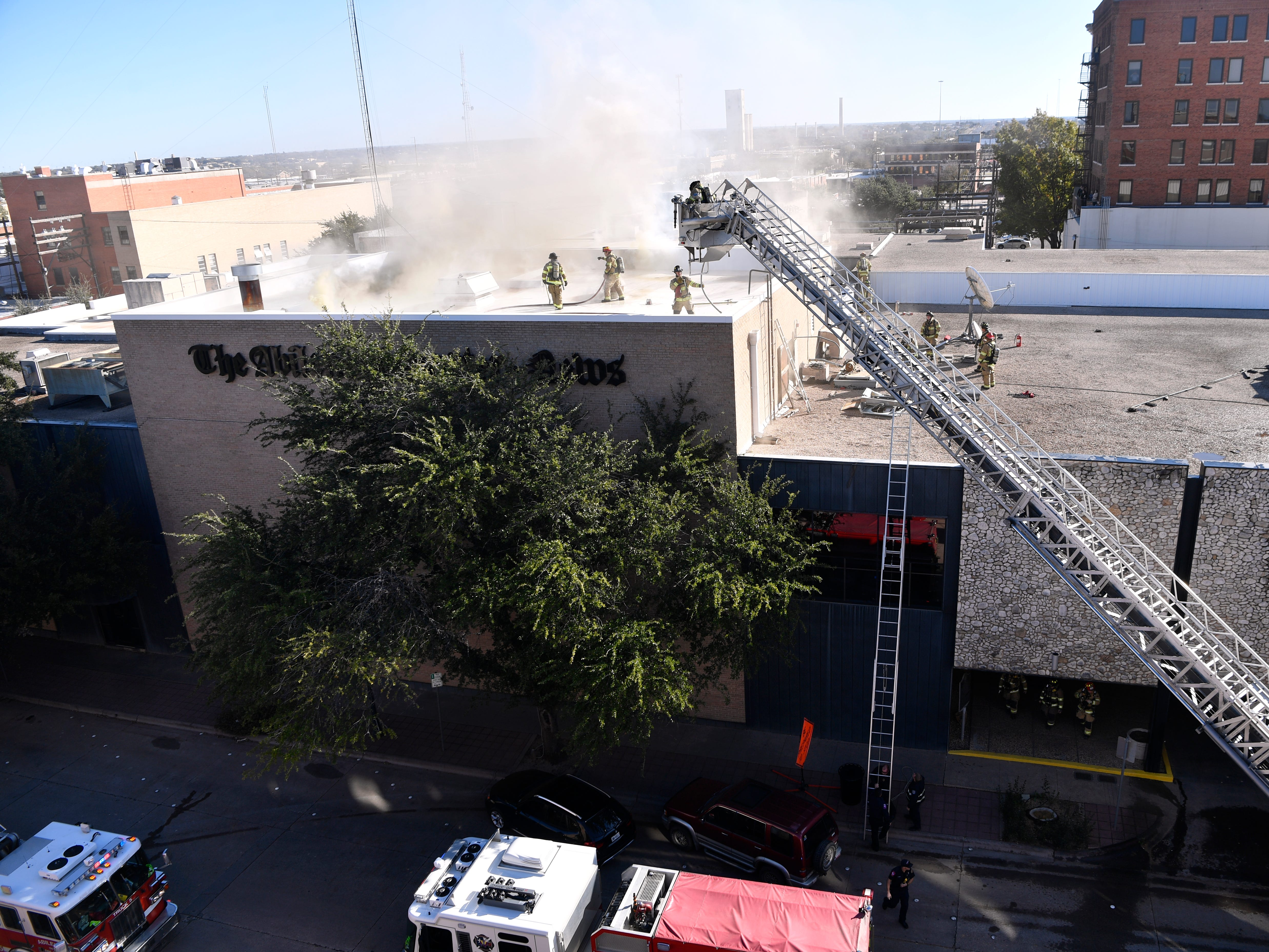 Abilene firefighters respond to a two-alarm blaze at the Abilene Reporter-News Thursday Nov. 15, 2018. The fire was called in at 9:20 a.m., at one time all three of the city's ladder trucks were employed during the fight.