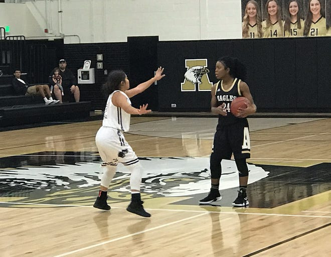Abilene High's Trakenya Roberson surveys the floor on an offensive possesion in the first of the Lady Eagles 53-26 win over El Paso Franklin Thursday, Nov. 15, 2018.