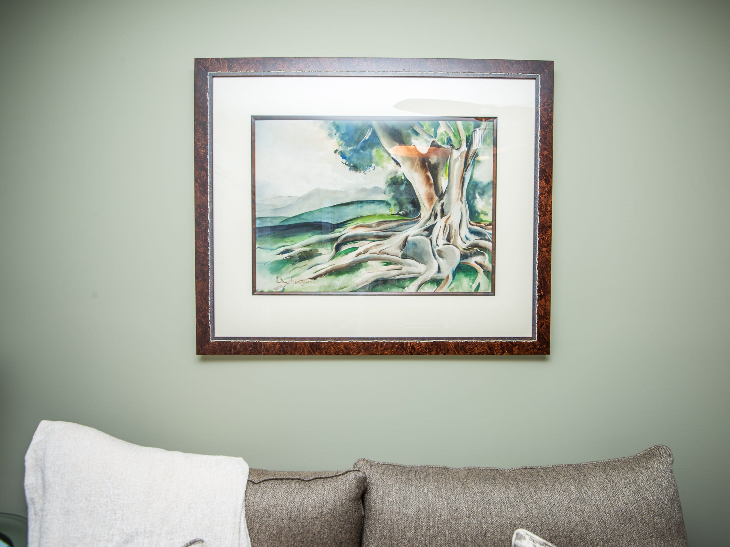 Art in a bedroom at the home of Pat and Ron Hart in Asheville's Montford neighborhood.