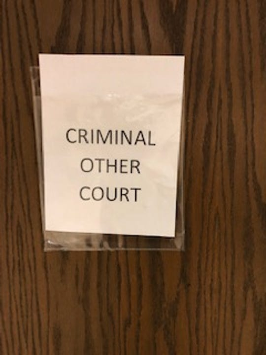 A sign on a courtroom door in a small town in Western North Carolina. You figure it out.