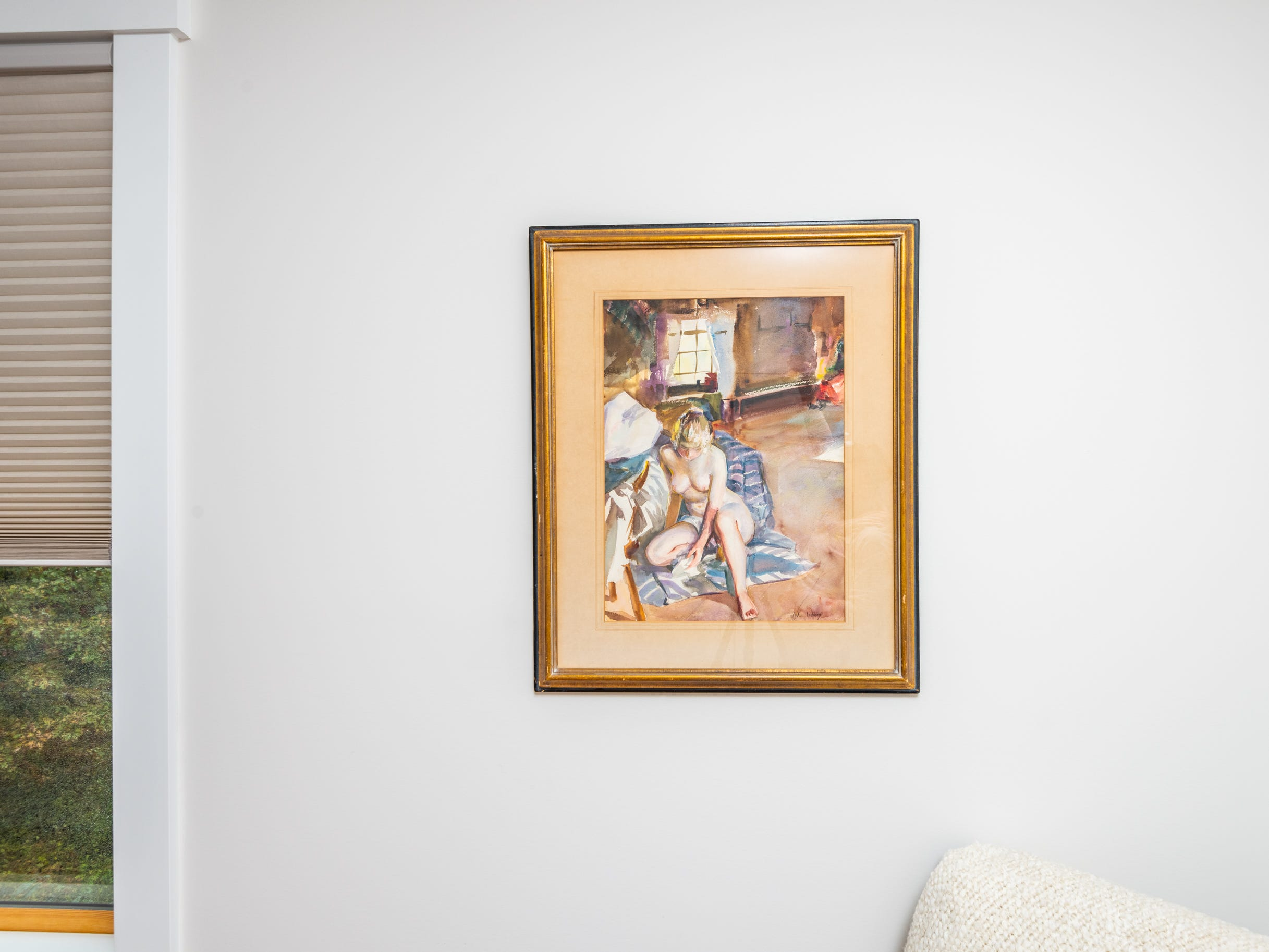 Art in bedroom at the home of Pat and Ron Hart in Asheville's Montford neighborhood.