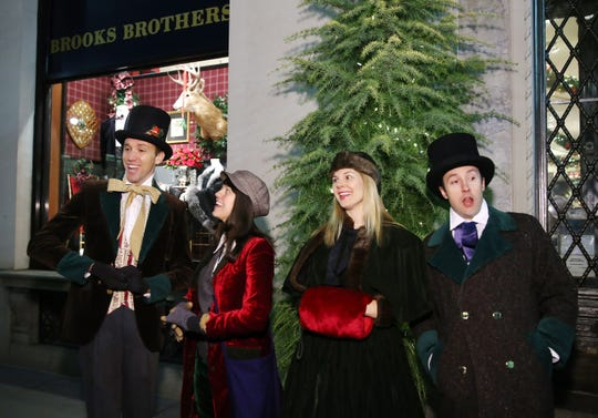 Carolers perform outside on December 12, 2013 in New York City.