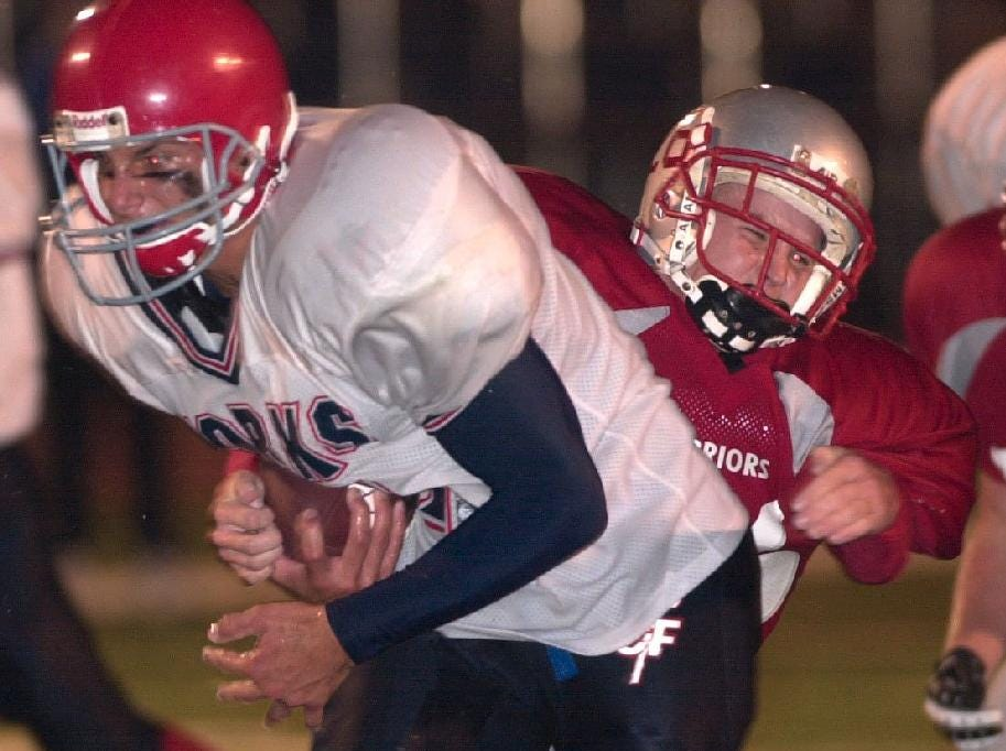 From 2001: Chenango Forks' quarterback Matt Juriga looks to the end zone, only to be dragged down short of the goal line by Chenango Valley's Kellen Spencer in the 3rd quarter at Alumni Stadium Friday night.