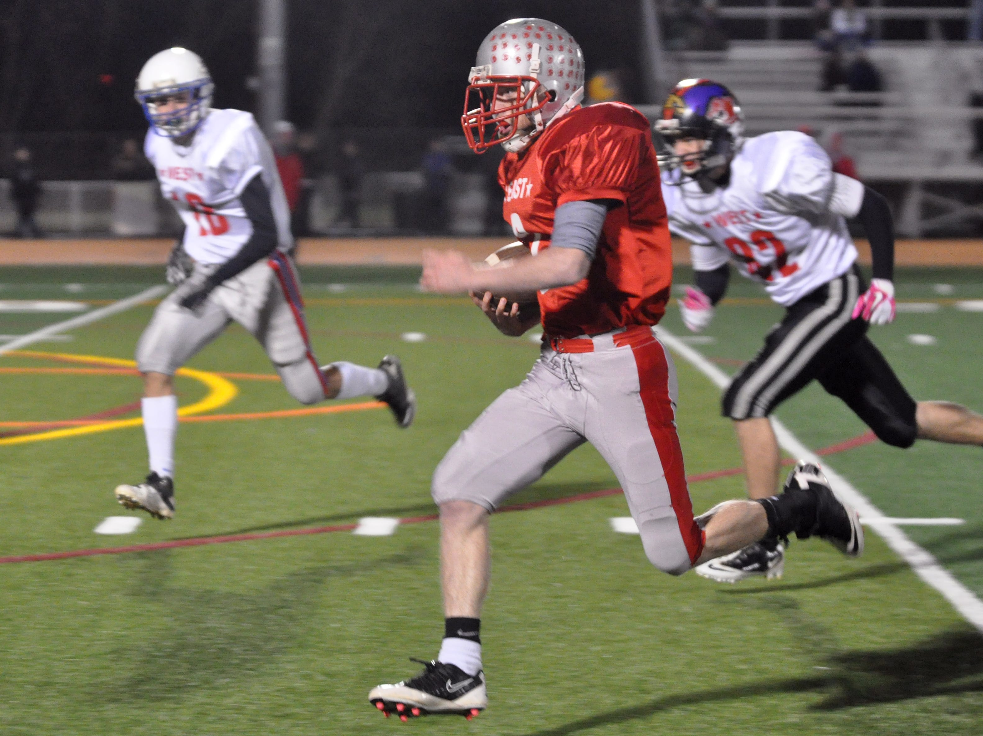 From 2011: Chenango Valley's Adam Greene blows past opponents of the West Squad to score a touchdown for East in the first quarter of the 2011 Ernie Davis All-Star Football Classic held at Union-Endicott's Ty-Cobb Stadium on Wednesday night.