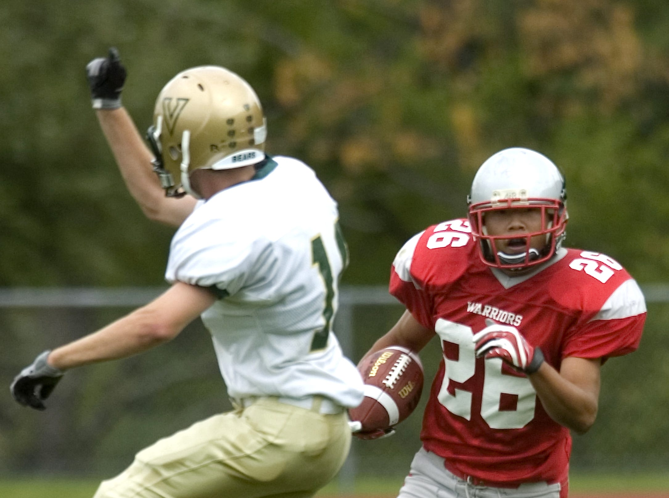 From 2009: Chenango Valley's Devin Carroll, right, works around Vestal's Nick Keeler in the first quarter of Saturday's game at CV.