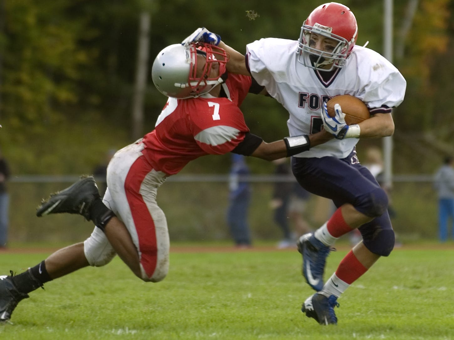 From 2012: Chenango Valley's Anthony Miller tackles Chenango Forks' Jake Green in the first half Saturday at CV. Forks won, 15-13, in two overtimes.