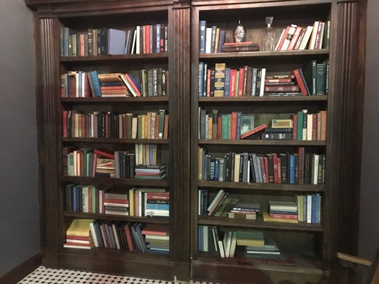 The entrance to Downtown Binghamton speakeasy 205 Dry is hidden by a massive book case.