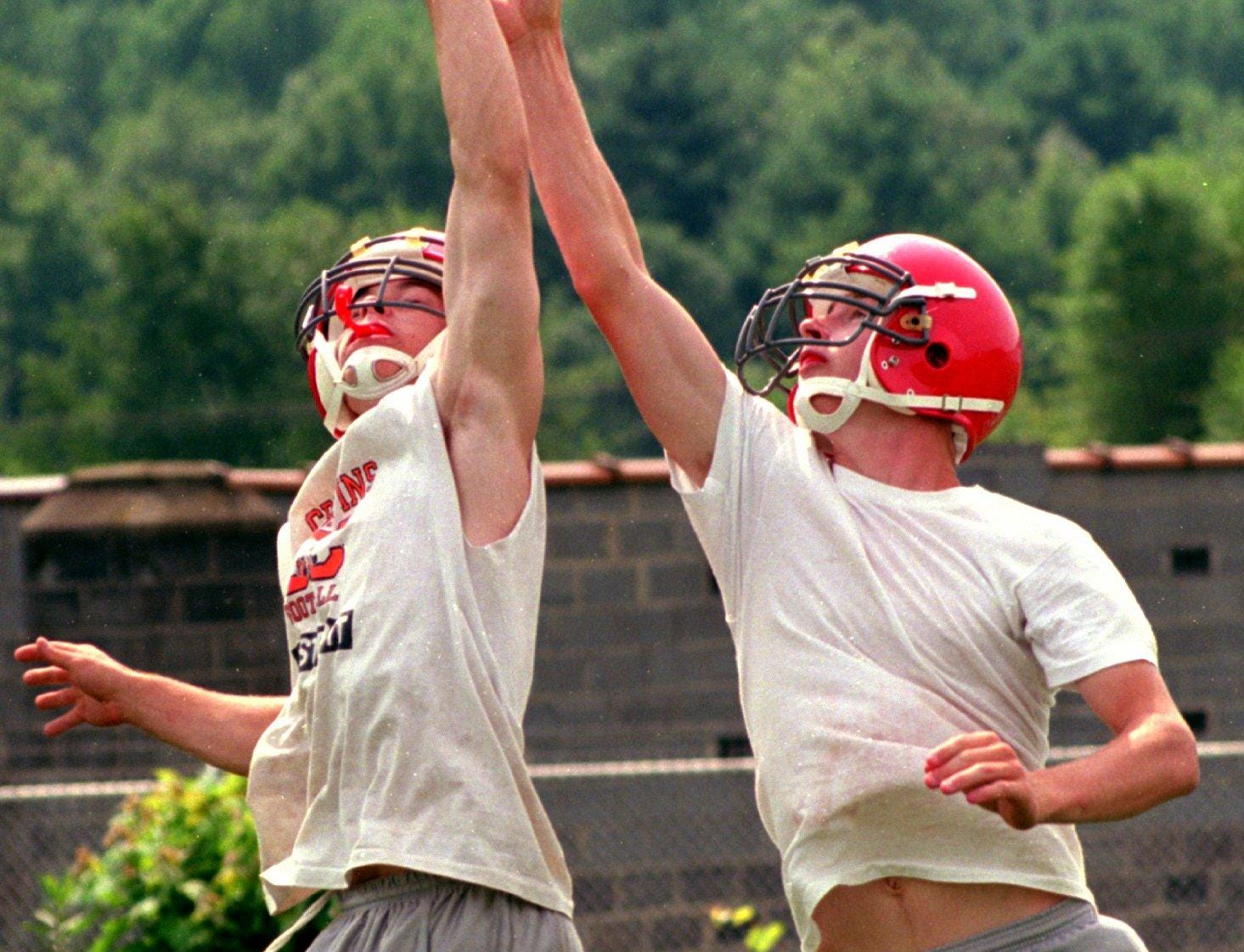 From 1996: Chenango Valley Football players Lenny Gee, left, and Dan Clark, right, reach for the ball at a recent practice.