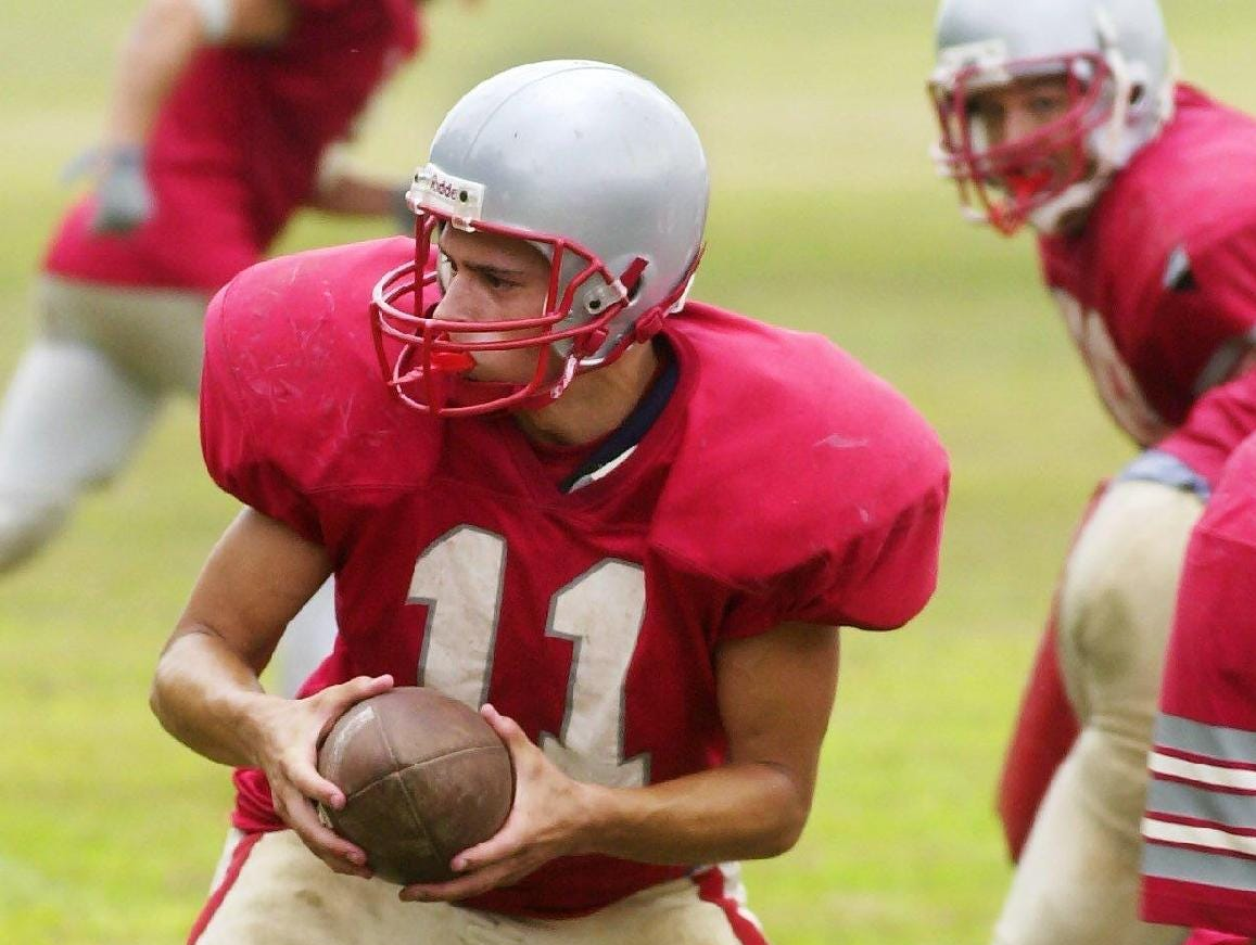 From 2001: Chenango Valley's quarterback Scott Cooley makes a handoff during teams practice.