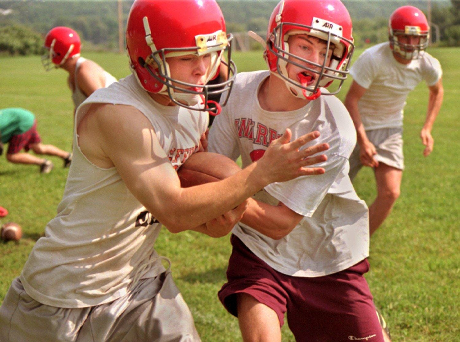From 1996: Chenango Valley Chenango Valley Football players Leonard Gee, left, and Tom Sisson, right, fight for the ball during a recent practice.